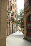 Street view in Barcelona, Spain. Street view with old stone buildings in Barcelona, Spain royalty free stock images