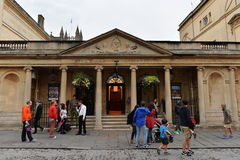 Street View in Bath England. Tourists and locals walk past the historic Roman Baths on August 9, 2014 in Bath, UK. The roman era baths are a major attraction Stock Images