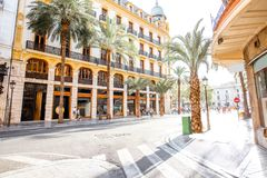 Valencia city in Spain. Street view with beautiful buildings and palm trees in Valencia city in Spain Royalty Free Stock Images