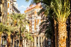 Valencia city in Spain. Street view with beautiful luxurious building and palm trees in Valencia city during the sunny day in Spain Royalty Free Stock Image