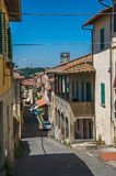 Street view with bell tower and buildings on sunny day in Montelupo Fiorentino. Royalty Free Stock Photo