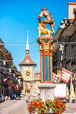 Street view in Bern city. Street view on Kramgasse with fountain and clock tower in the old town of Bern city. It is a popular shopping street and medieval city royalty free stock images