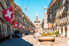 Street view in Bern city. Street view on Kramgasse with fountain and clock tower in the old town of Bern city. It is a popular shopping street and medieval city royalty free stock photos