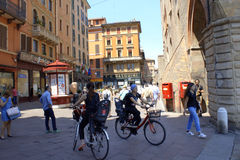 Street view Bologna Italy. Women biking in Bologna old city streets, mass view in the city,Italy Royalty Free Stock Photo