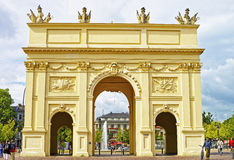 Street view on Brandenburg Gate and a fountain in Potsdam Royalty Free Stock Photo