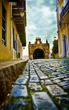 Street view of bricks. A low level street view of a church and buildings in old San Juan, Puerto Rico Royalty Free Stock Photos