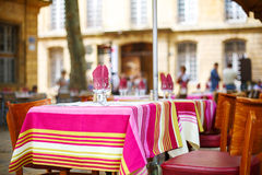 Street view of a cafe terrace with empty tables and chairs, Prov Royalty Free Stock Photography