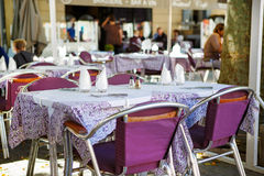 Street view of a cafe terrace with empty tables and chairs, Prov Stock Photography
