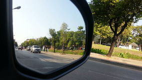 Street view from car side mirror Royalty Free Stock Photos
