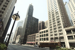 Street view of Chicago downtown. Urban landscape with towers and Royalty Free Stock Images