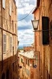 Street view of city Siena, Italy Royalty Free Stock Photo
