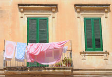 Street view with clothesline, Italy Royalty Free Stock Photo