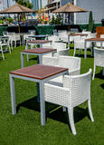 Street view of a coffee terrace with tables and chairs Royalty Free Stock Photography