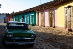Street view of colored houses in Trinidad with old-timer car stock images