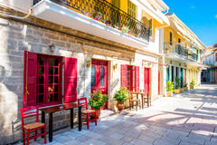 Street view with colorful old houses in Greece Stock Images
