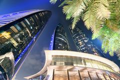 Street view of Corniche Road buildings at night, Abu Dhabi.  Stock Photos