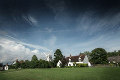 Street view of cottages and windmill in Finchingfield, England Royalty Free Stock Photography