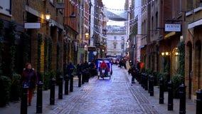 Street view at Covent Garden London - LONDON, ENGLAND - DECEMBER 10, 2019