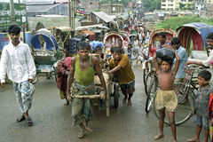 Street view Dhaka with Bangladeshi workers at work Royalty Free Stock Photo