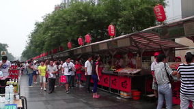 Street view of Donghuamen snack street at daytime, HD. stock footage