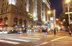 Street view in Downtown San Francisco at night - SAN FRANCISCO - CALIFORNIA - APRIL 17, 2017. Street view in Downtown San Francisco at night Stock Image