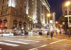 Street view in Downtown San Francisco at night - SAN FRANCISCO - CALIFORNIA - APRIL 17, 2017. Street view in Downtown San Francisco at night Royalty Free Stock Images