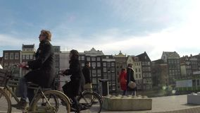 Street view of a Dutch canal in Amsterdam stock video