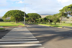 Street view. A view of an empty street intersection with the crosswalk, Kapolei, Oahu, Hawaii, USA Royalty Free Stock Photos