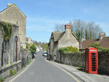Street View of an English Town. General Street View of a Typical English Town with Stone Cottages and a Red Telephone Box Stock Image