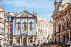 Porto city in Portugal. Street view on the facade with beautiful blue tiles of Congregados church in Porto city, Portugal royalty free stock photography