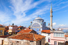 Street view with Fatih Camii mosque, Izmir, Turkey. Street view with old living houses and Fatih Camii (Esrefpasa) old mosque, Izmir, Turkey Royalty Free Stock Photo