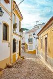 Street view of Ferragudo, Portimão, Portugal. Beautiful street view of Ferragudo with cloudy blue sky, Portico, Algarve, Portugal royalty free stock photography