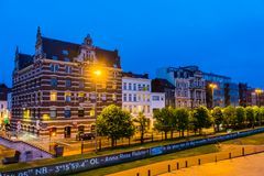 Street view of the flemish quay in antwerp city, entrepot du congo building with other other buildings, Antwerpen, belgium, April. A street view of the flemish royalty free stock photos