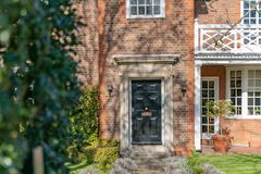 Street view of front door - a typical English residential old London town house royalty free stock photo