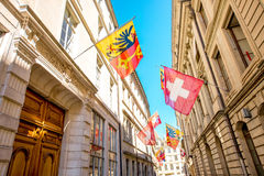 Street view in Geneva city. Street view with Swiss flags on the buildings in the old town of Geneva city in Switzerland Stock Photos