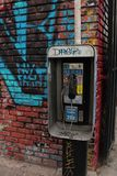 Street View with Graffiti Pay Phone Stand stock photo