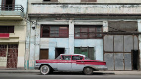 Street View Havana 3. A beautiful oldsmobile parked in front of old warehouse in a street of the old district of Havana, near the Malecon, Cuba Royalty Free Stock Photography