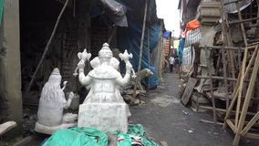 Street view of Kumartuli. Street view of  Kumartuli or Kumortuli, in Calcutta now Kolkata, West Bengal, India, South Asia on July 3, 2017. Kumartuli a stock video footage