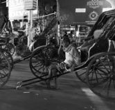 Street view. May be the last bevy of human powered tana rickshaws royalty free stock photo