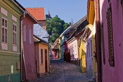 Street view in medieval city of Sighisoara (Transy. Sighisoara is a medieval city in Transylvania (Romania), built on the site of a Roman fort by Germans ( stock photography