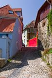 Street view in medieval city of Sighisoara (Transylvania, Romania). Sighisoara is a medieval city in Transylvania (Romania), built on the site of a Roman fort by Royalty Free Stock Photos
