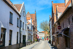 Street view with medieval traditional houses, people in Bruges, Belguim Royalty Free Stock Photo