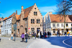 Street view with medieval traditional houses, people in Brugge, Belguim Stock Photos