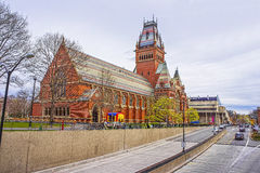 Street view on Memorial Hall in Harvard University in Cambridge. V+Cambridge, USA - April 29, 2015: Street view on Memorial Hall and tourists in Harvard Royalty Free Stock Image
