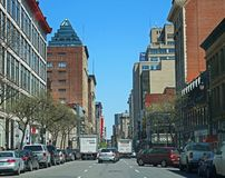 Street View On Montreal`s Rue St. Catherine. Looking east on St. Catherine Street in downtown Montreal, Quebec, Canada, quite near the old Montreal Forum, a royalty free stock images