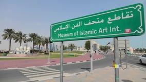 Street view of Museum of Islamic Art of Doha. Doha, Qatar - February 20, 2019: street view of Museum of Islamic Art of Doha in Doha park with road sign. Qatar stock video
