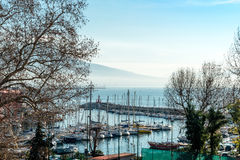 Street view of Naples harbor with boats Royalty Free Stock Photography