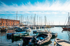 Street view of Naples harbor with boats Royalty Free Stock Photos
