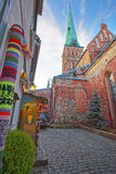 Street view near St James Cathedral in the Old city of Riga in L Stock Photos