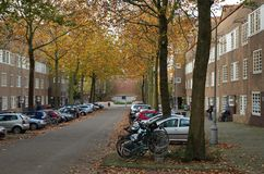 Street view in the Nieuwe Pijp. Amsterdam, Netherlands - 25 October, 2015: Wide view of the Amsterdam School buildings of the Pieter Lodewijk Takstraat Stock Image